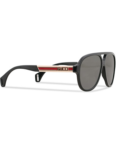 GUCCI GG0463S Sunglasses Black/White/Grey  i gruppen Assesoarer / Solbriller hos Care of Carl (15860710)